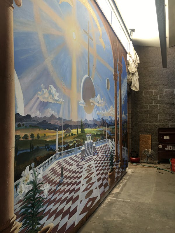 Photo of the mural in the choir room under renovation