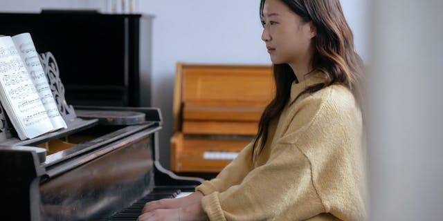 A Girl Learning How to Play the Piano