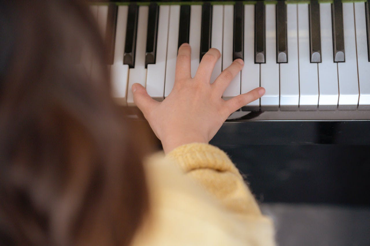 A Hand Playing a Piano at a Piano Lesson