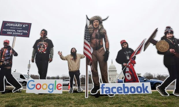 "Protestors portray Zuckerberg as the infamous ""QAnon Shaman"" Credit: Jonathan Ernst/Reuters"