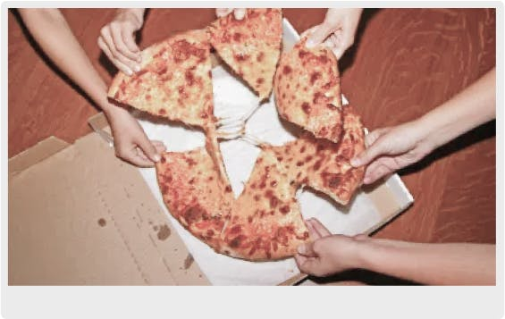 People grabbing a slice of pizza