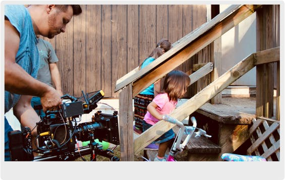 The Director of Photography capturing a scene of two young girls