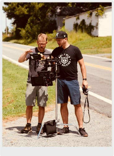 The Director of Photography filming a scene