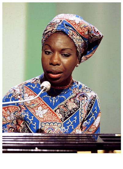 Nina Simone playing piano and singing