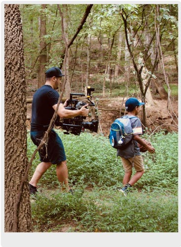 Director of Photography filming a music video in the woods