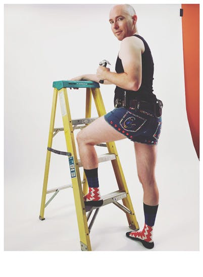 A man on a ladder at a video shoot for Stance Socks and bedazzled shorts