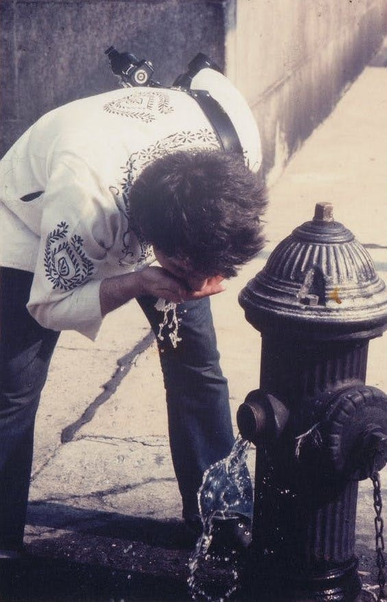"""Alvin Baltrop, """"Man Drinking from Fire Hydrant,"""" New York"""