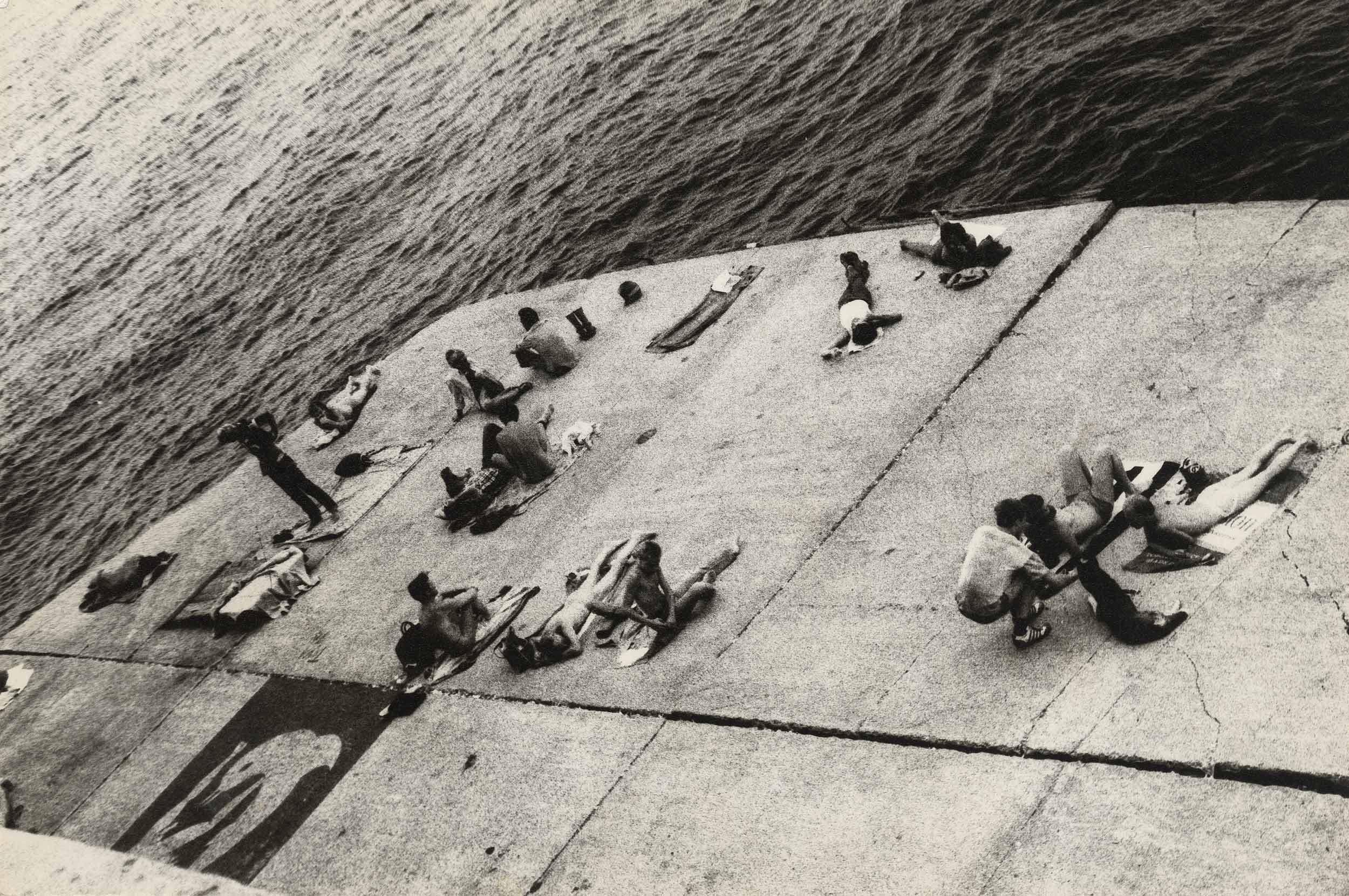 "Alvin Baltrop, ""Sunbathing Platform with Tava Mural,"" West Side Piers, New York, c. 1980"