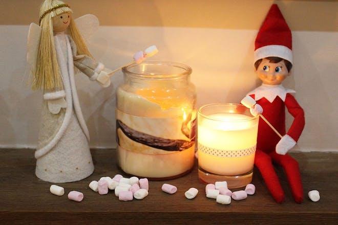 elf toasting marshmallows on candle