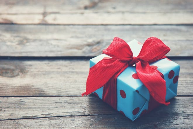 wrapped present on wooden floor