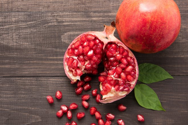 A picture of a pomegranate and pomegranate seeds