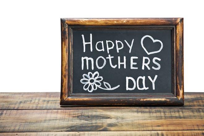 chalkboard with happy mothers day written on it