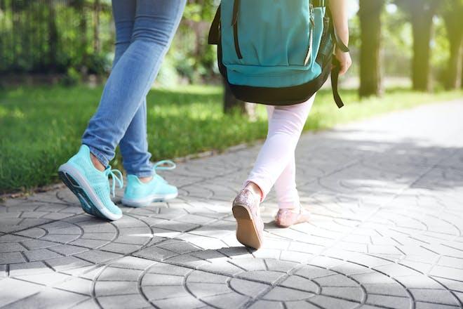 mum and girl walking to school
