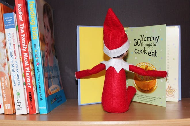elf reading cooking book