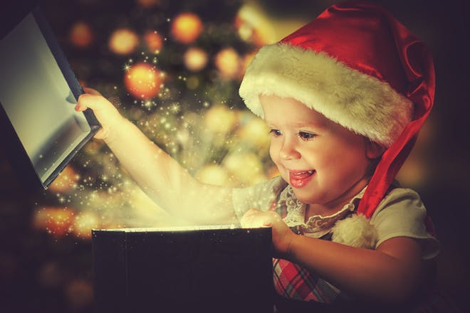 baby boy opening christmas present