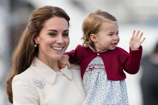Kate Middleton and Princess Charlotte waving