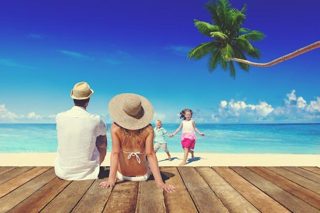 family on holiday on beach