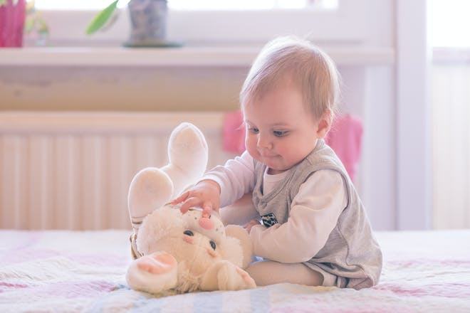 baby girl playing with toy