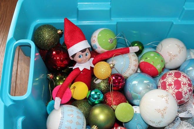 elf in decorations box