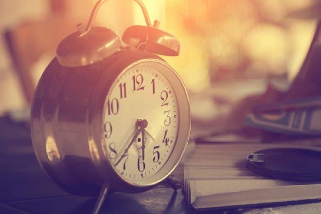 bedside alarm clock on table