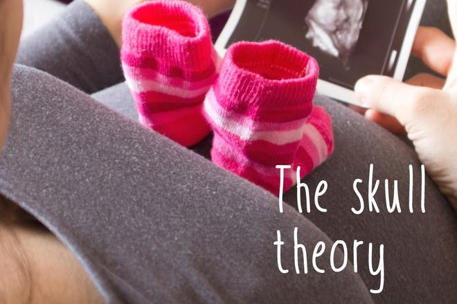 pregnant woman with pink socks and baby scan photo