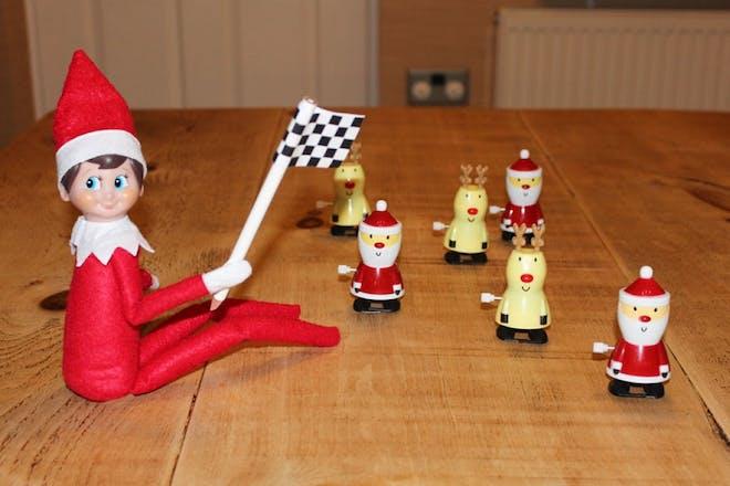 elf having santa and reindeer race