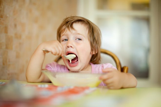 Child eating breakfast.