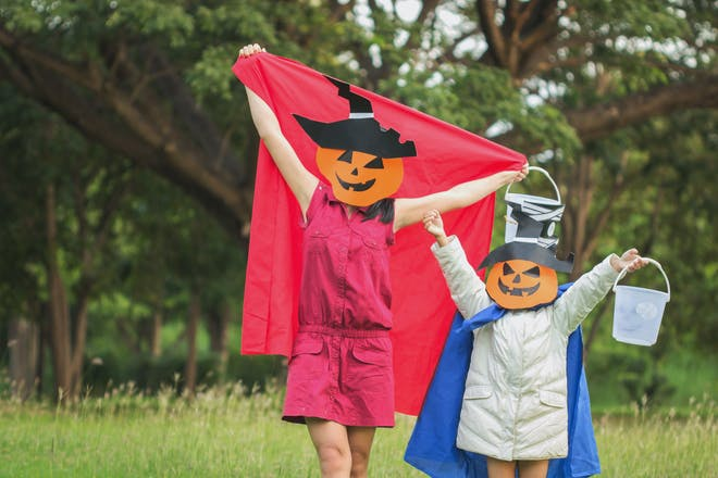 woman and child in halloween masks
