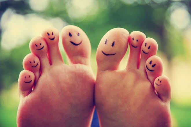 bare feet with happy faces