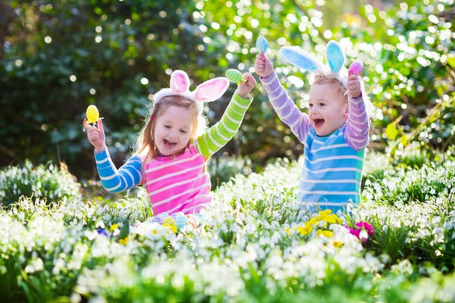 two girls hunting for easter eggs