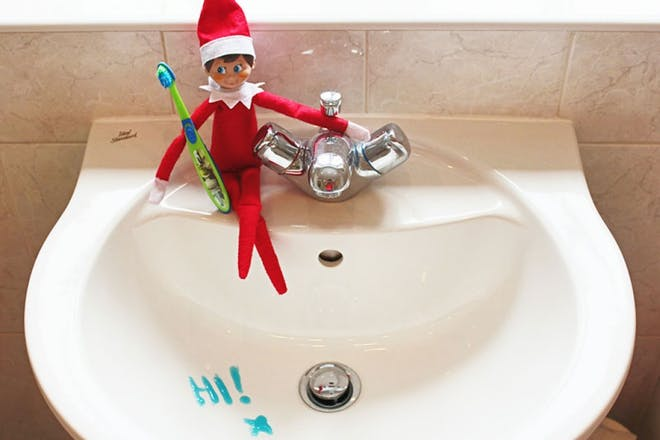 elf in bathroom basin
