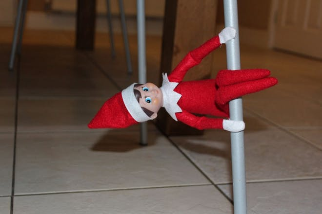elf sitting on chair leg