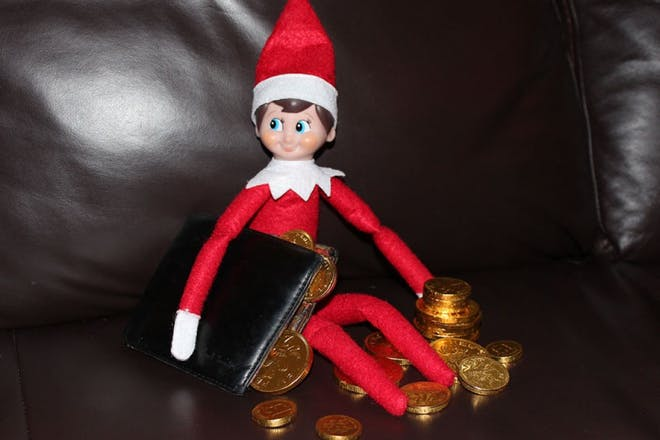 elf getting coins from wallet