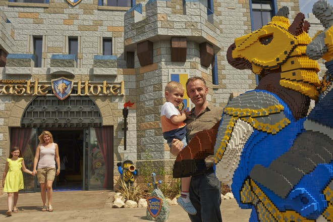 Family outside Legoland Castle Hotel with Lego Knight on horse