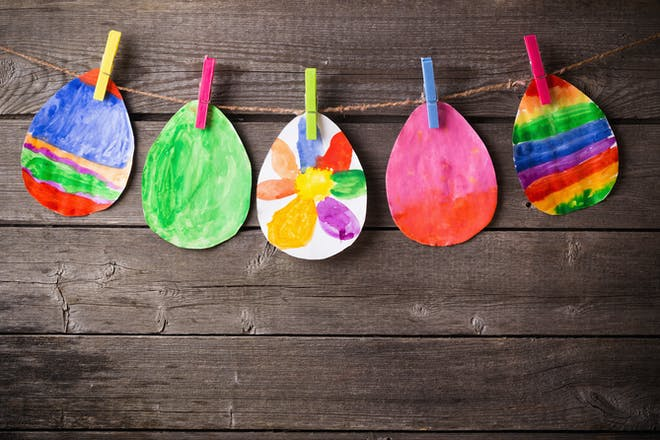 colourful paper eggs on pegs
