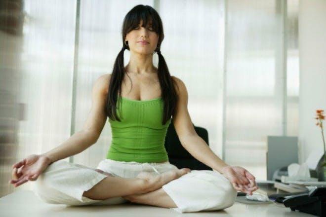 woman in greet shirt meditating