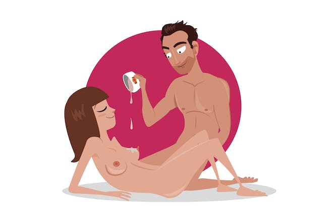 man pouring wax on naked woman