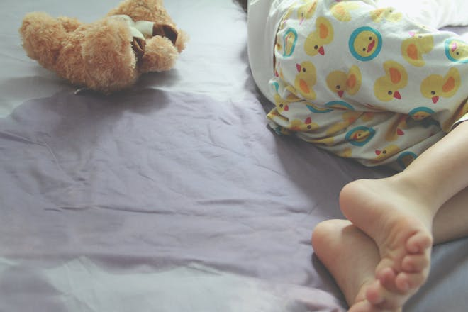 School aged child wet the bed