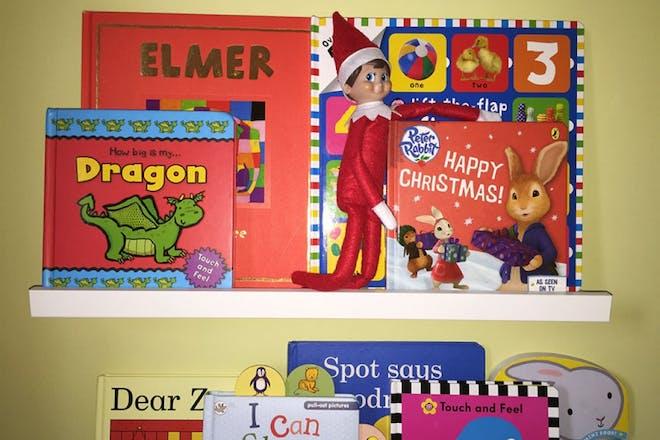elf on book shelf