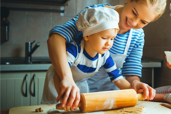 Little boy baking with mother in mother-son bonding