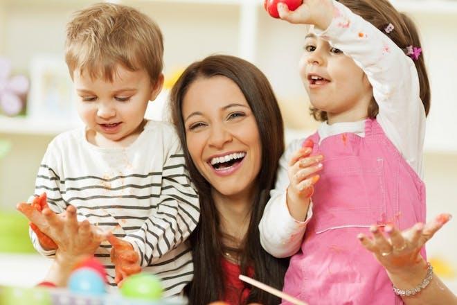 mum with children in kitchen happy