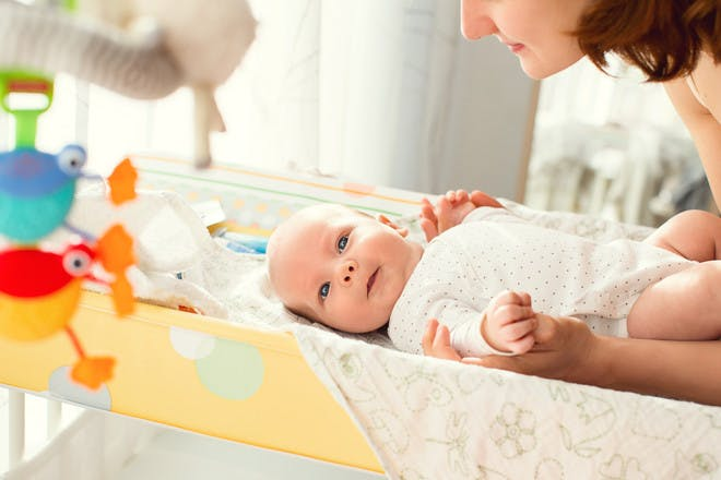 baby on changing mat