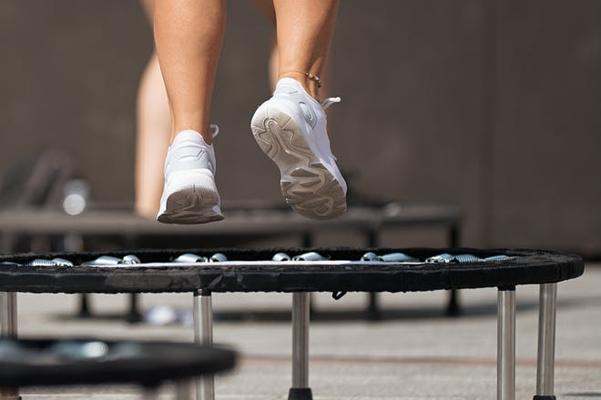 Woman jumping on trampoline