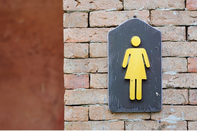 Woman's toilet sign
