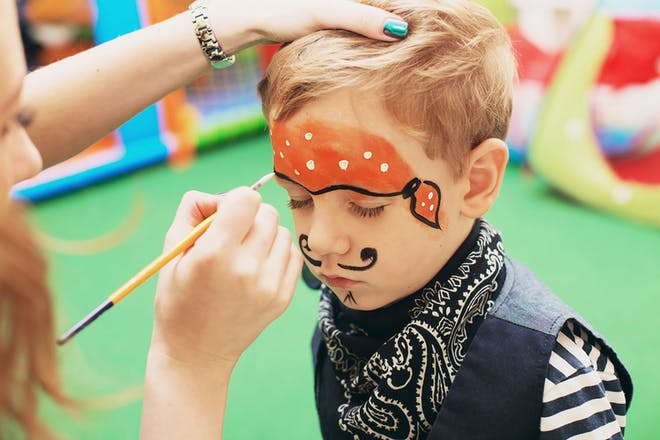 Child having face painted like a pirate