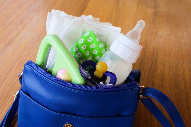 handbag full of baby essentials