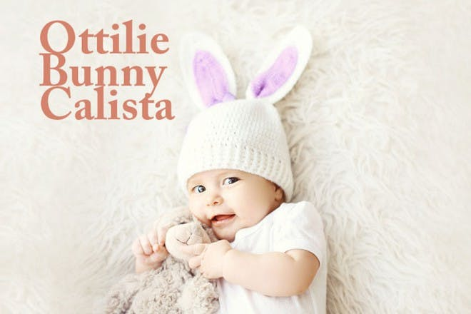 little girl wearing bunny hat holding teddy