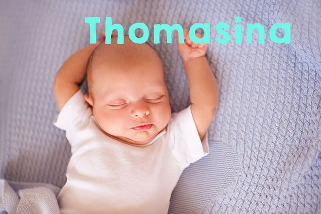 Sleeping baby with arms overhead. Text says Thomasina
