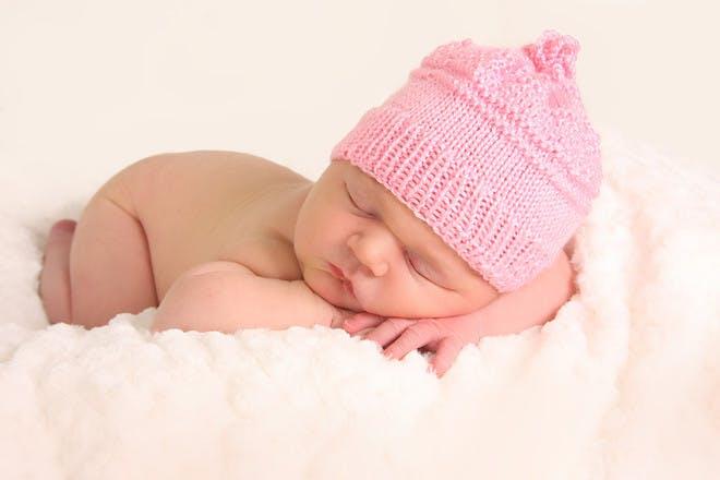 Baby sleeping in pink hat