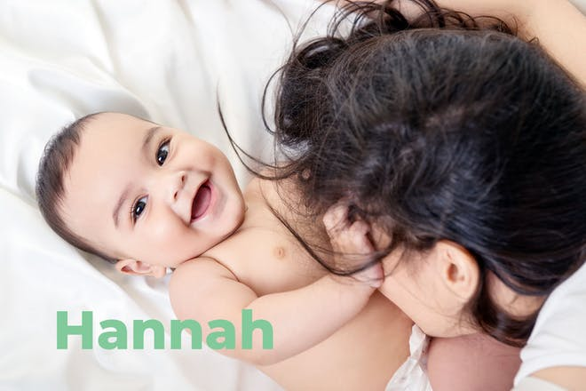 Baby laughing and pulling mum's hair. Name Hannah written in text